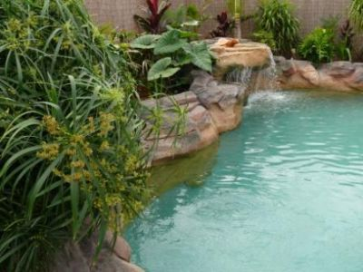 Landscape Designer built this pool and wanted the natural feel of Man Made Rock so he could incorporate his beautiful garden.